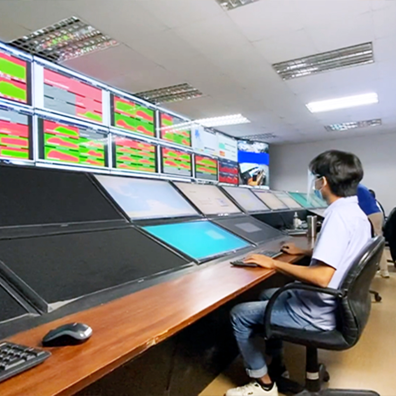 An operator in front of a control console