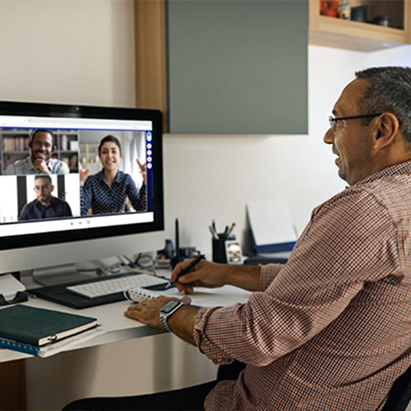 A man attends a virtual meeting
